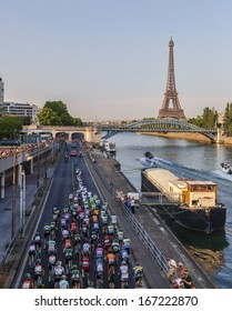 PARIS,JUL 21:The peloton riding on the Seine riverside near the Eiffel Tower during the last stage of the 100th edition of Le Tour de France on July 21, 2013 in Paris