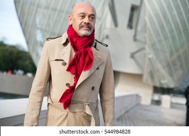 PARIS-JULY 5, 2016. Christian Louboutin is going to a fashion show at Louis Vuitton Fondation. Ready to wear. Paris fashion week.