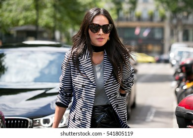 PARIS-JULY 6, 2016. Chinese Actress and Stylist Tina Leung is on her way to Christian Dior fashion show. Haute couture. Paris Fashion week.