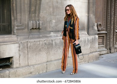PARIS-OCTOBER 2, 2015. Ece Sukan is going to a fashion show. Paris fashion week, street style.