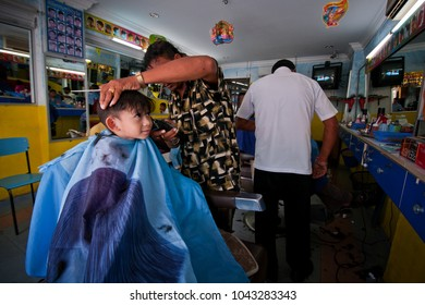 Parit Buntar, Perak / Malaysia - October 29 2011 ; Typical view of a traditional barber shop in Malaysia, image taken in a small town called Parit Buntar.