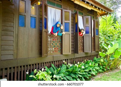 Parit Jawa, Johor, Malaysia - 6 July 2016, Happy children enjoying the Hari Raya Balik Kampung celebration after the fasting month Ramadan at a traditional Malay kampung house.