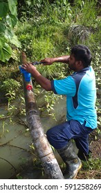 Parit, Malaysia, 1st Mac 2017 ; Contractor pipe repair the broken water pipe to ensure user get a clean water for life