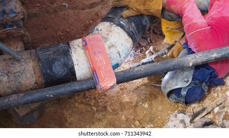 Parit, Perak, Malaysia, September 8, 2017:Pipe contractor is repairing burst pipe to ensure consumers get clean water for life