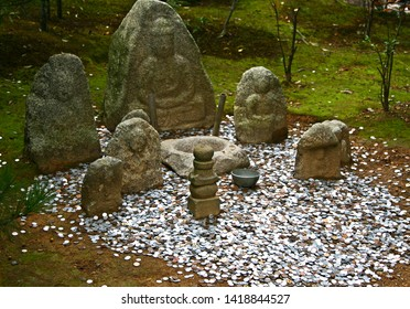 Park with ancient stone statues. a lot of coins. Japan.