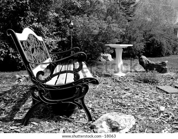 Park Bench with Bird Feeder