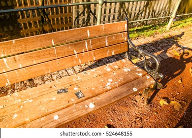 Park bench with bird poop