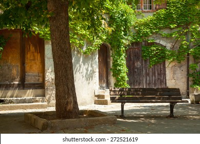 Park bench in a courtyard.  Avignon Provence France.