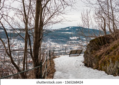 park bench on drammen spiral with drammen and mountains in the background