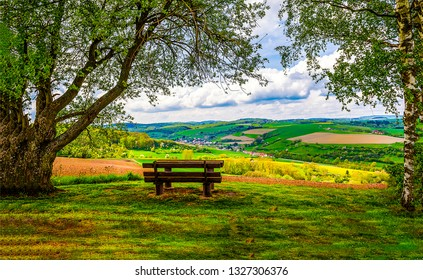 Park bench outdoor landscape. Wooden bench in mountains. Mountain park bench panorama. Park bench relax