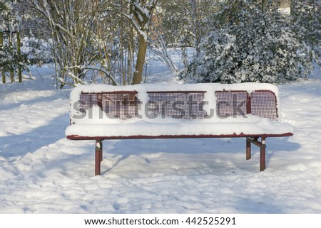 Park bench in the snow