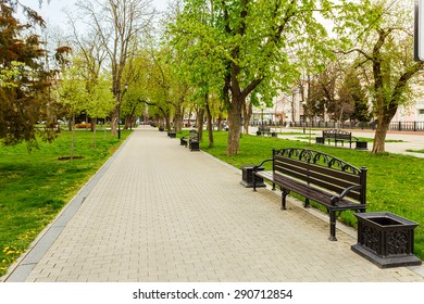 Park bench spring urban landscape recreation in city