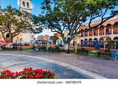 Park benches, the cathedral and colorful buildings in San Francisco de Campeche, Mexico