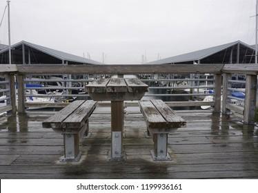 Park benches in the rain at Edmunds Washington