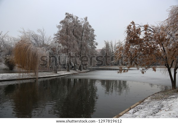 Park in Bucharest with semi frozen lake and trees