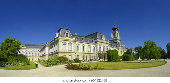 "Park and castle in Keszthely. Keszthely is town on the west end of Balaton. The oldest city by the lake is referred to as the ""capital of the Balaton,"" an important tourist region of Hungary"