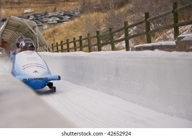 PARK CITY - DECEMBER 5: The Slovakia Four-Man Bobsled team crosses the finish line at the America's Cup Bobsled Races in Park City  December 5, 2009 in Park City, Utah.