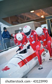 PARK CITY - DECEMBER 5: Team Canada pushes off at the start of their race in the  America's Cup Bobsled Races December 5, 2009 in Park City, Utah.