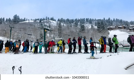 Park City, UT, March 4, 2018: Skiers stand in line to board the chair lift when it opens in the morning following an overnight snowfall.