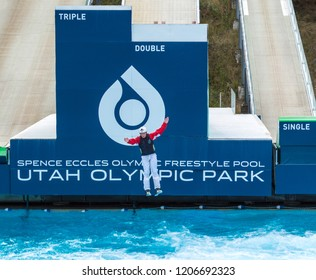 Park City, Utah/USA - Oct. 6, 2018: male freestyle skier about to land in a pool after a practice run down a ski ramp at Utah Olympic Park