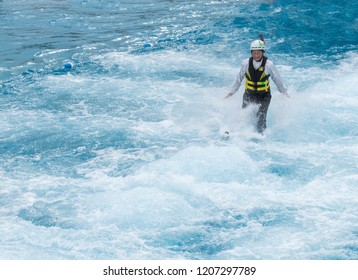 Park City, Utah/USA - Oct. 6,2018: female Asian freestyle skier landing in a pool after a practice ski jump at Utah Olympic Park