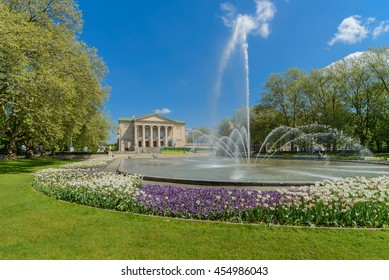 park and fountain before opera house in Poznan, Poland