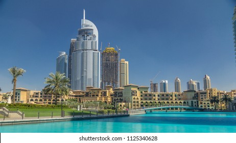 Park with fountain pool and bridge timelapse in Downtown, Dubai, United Arab Emirates