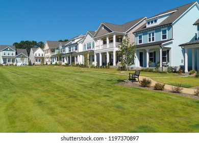 Park in front of suburban homes