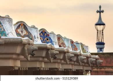 Park Guell in Barcelona. Doric columns with creature heads support the central terrace with serpentine seating