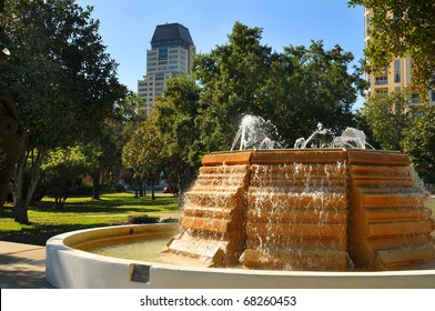Park located in the business district across from the waterfront in St. Petersburg, Florida. Sidewalks, trees and benches invite people time to reflect and enjoy the beauty of the coastal city.