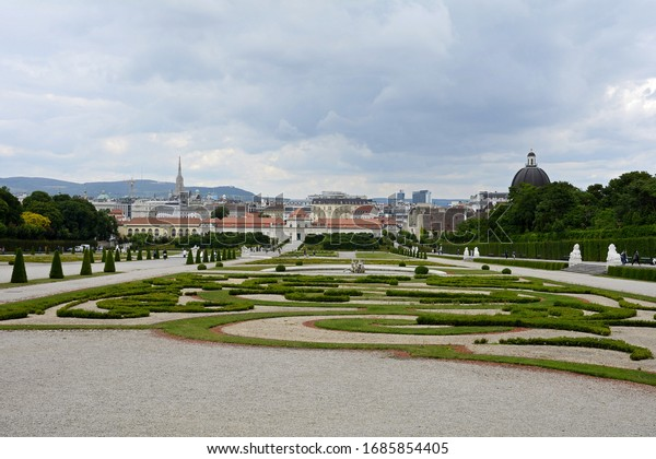 Park and Lower Belvedere Palace. Vienna. Austria. 06/24/2019. Living quarters of Prince Eugene of Savoy. Baroque palace complex. Alpine garden. Trees, hedges, sculptures, fountains and cascades.