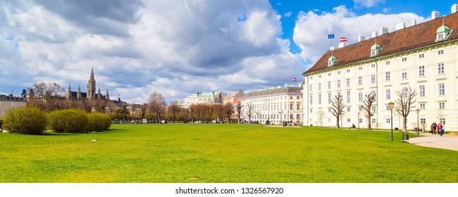Park near Hofburg, Vienna Town Hall Rathaus, Austria panoramic view