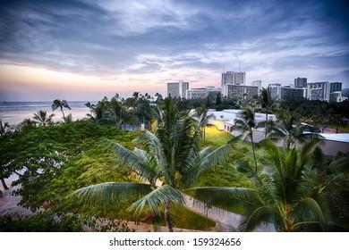 The park near Waikiki Beach with the city skyline of Oahu, Hawaii