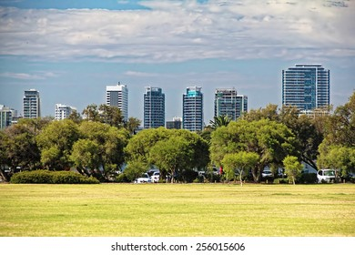 A park with office buildings skylines as a background