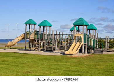 At a park playground with a giant jungle gym.
