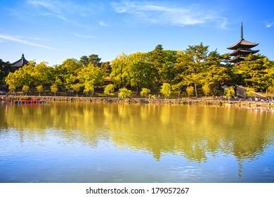 Park, pond reflection and Toji temple pagoda in Nara city. Japan, Asia.