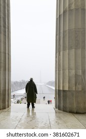 A park ranger silhouette standing between Lincoln Memorial columns with National Mall view - Washington DC USA