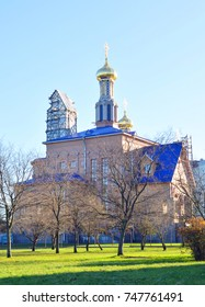 Park in Rybatskoe and The Church of the Nativity of the Blessed Virgin Mary at sunny autumn day in St.Petersburg, Russia.