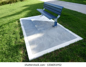 Park seating bench on top of a concrete slub