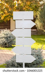Park Sign Post Directions. White signposts sign in the park. White  wooden direction sign