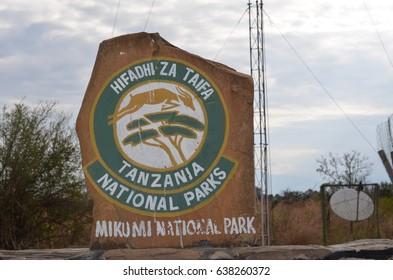Park signpost  at Mikumi National Park in Tanzania welcome to mikumi