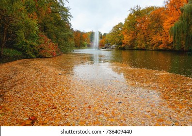 Park Sofiyivka (Sofievka), Uman', Cherkasy region, Ukraine. Golden autumn, the trees are covered with yellow, red, green leaves. Fountain of the snake. Water reflection in pond.