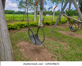 Park with swing made with car tire. Children's toy made from recycled material