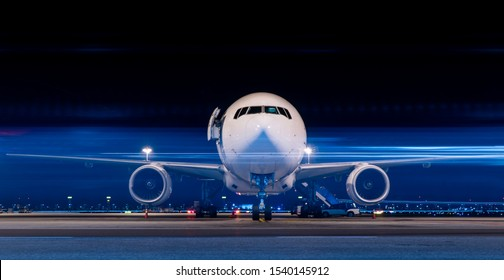 Parked aircraft in night with moving light