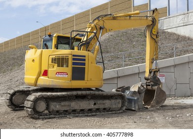 Parked Backhoe At Construction Site