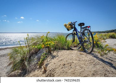 Parked Bicycle With Basket On Beach Bike Path