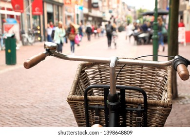 Parked bicycle with shopping basket
