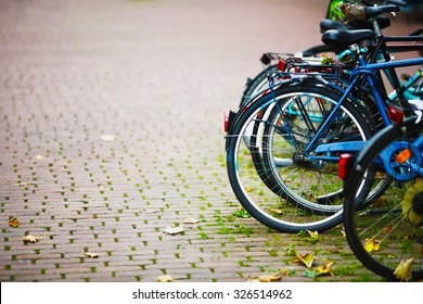Parked Bicycles On Sidewalk. Bike Bicycle Parking On The Street
