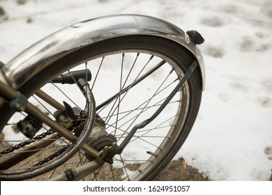 Parked Bike Outside in the Snow