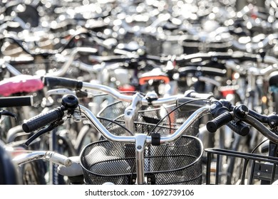Parked bikes on a huge bicycle parking lot.